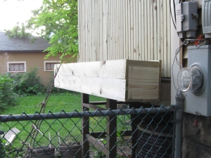 8-foot planter box on short end of deck, hovers above the container garden below. The squash trellis will rest against it.