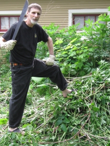 Lord of the Weeds! Let no one come between a man with a machete and a mission. Those weeds sneaking up behind him are relatives to the ones he just slaughtered and they are almost as tall as he. Imagine 1/4 of our yard filled with a 5-foot forest.