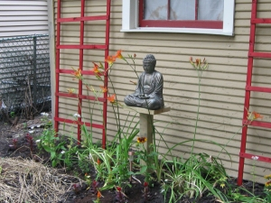 Close up of Buddha with red trellises. I may have to tone down the red a bit.