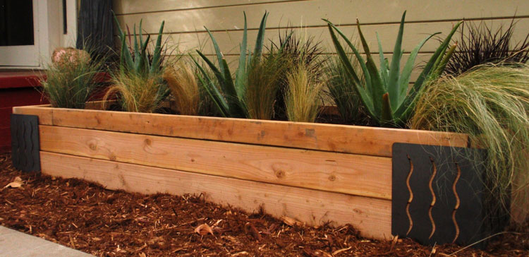 Raised bed showing use of M Brace for corners and modern drought plantings.
