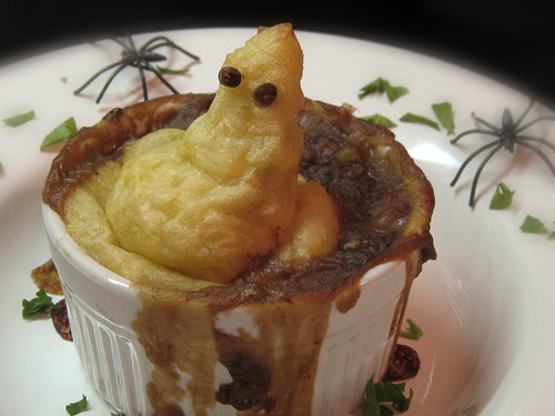 Use a ziploc with the corner cutoff to squeeze out easy ghosts made fromo mashed taters on shepherd's pie. Lentils for eyes.